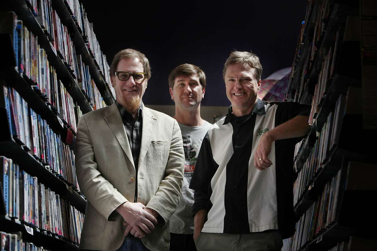 Kevin Hunsanger (l to r), Pete Mulvihill and Kevin Ryan, co-owners of Green Apple Books and Music, pose for a portrait at Le Video on Monday, April 14, 2014, in San Francisco, Calif.