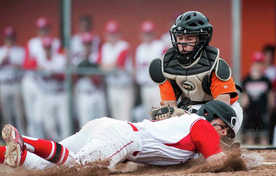 Shelton high school catcher Marc Zoppi makes the tag and Cheshire high school's Cooper Mrowka is out at the plate during a boy's baseball game played at Shelton high school, Shelton, CT on Monday, April,14th, 2014. Photo: Mark Conrad / Connecticut Post Freelance