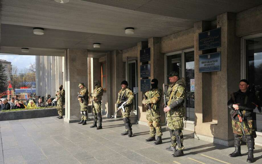 Armed men  guard a regional administration building in  eastern Ukraine. Russia, evidently, has a plan of aggression. Photo: Genya Savilov / Getty Images / AFP