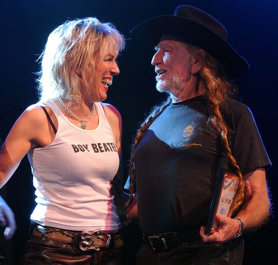 Lucinda Williams and Willie Nelson, pictured onstage at South by Southwest in 2003, both played the early years of the Kerrville Folk Festival. (AP file photo) Photo: DEBORAH CANNON, AP