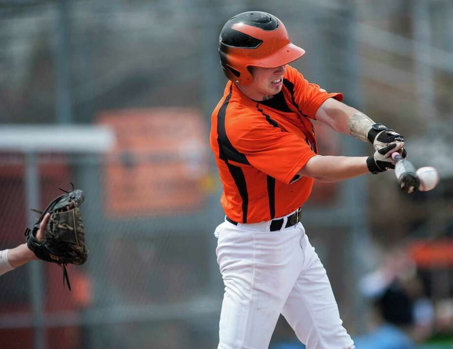 Shelton high school's Carl Rizzo makes contact with the ball during a boy's baseball game against Cheshire high school played at Shelton high school, Shelton, CT on Monday, April,14th, 2014. Photo: Mark Conrad / Connecticut Post Freelance