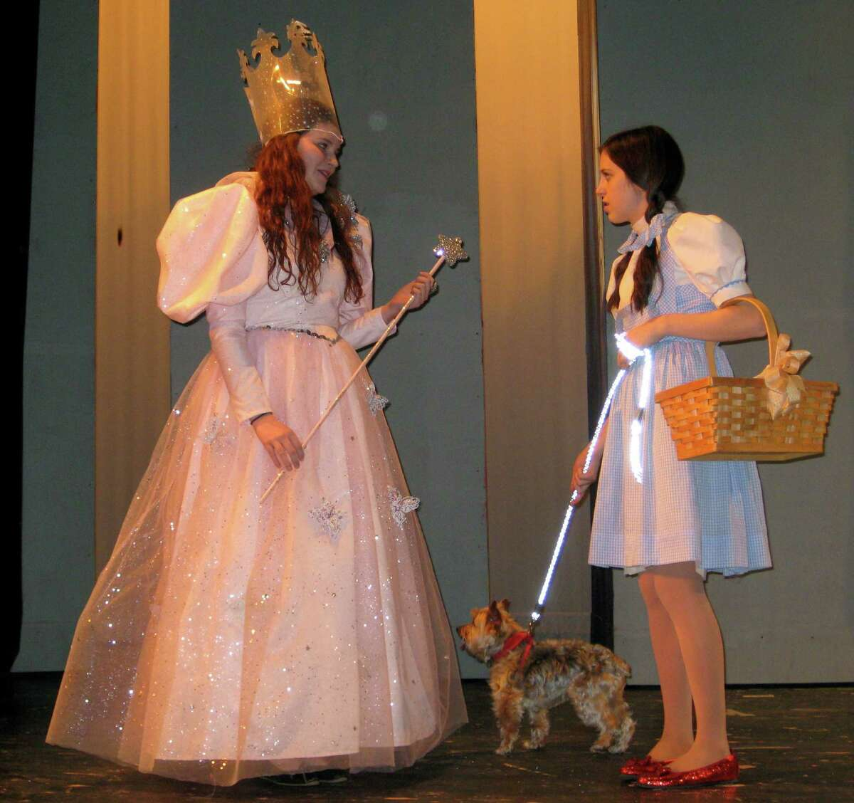 """Erin Valade, right, stars as Dorothy, and Katie Middleton plays Glinda the good witch in this rehearsal scene from Fairfield Ludlowe High School's production of """"The Wizard of Oz."""" The show is slated Friday, April 25 and Saturday, April 26."""