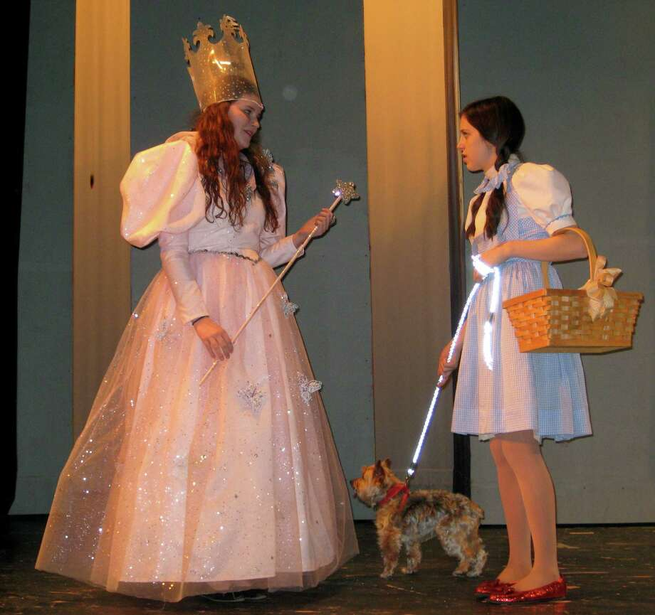 "Erin Valade, right, stars as Dorothy, and Katie Middleton plays Glinda the good witch in this rehearsal scene from Fairfield Ludlowe High School's production of ""The Wizard of Oz."" The show is slated Friday, April 25 and Saturday, April 26. Photo: Fairfield Citizen/Contributed / Fairfield Citizen"