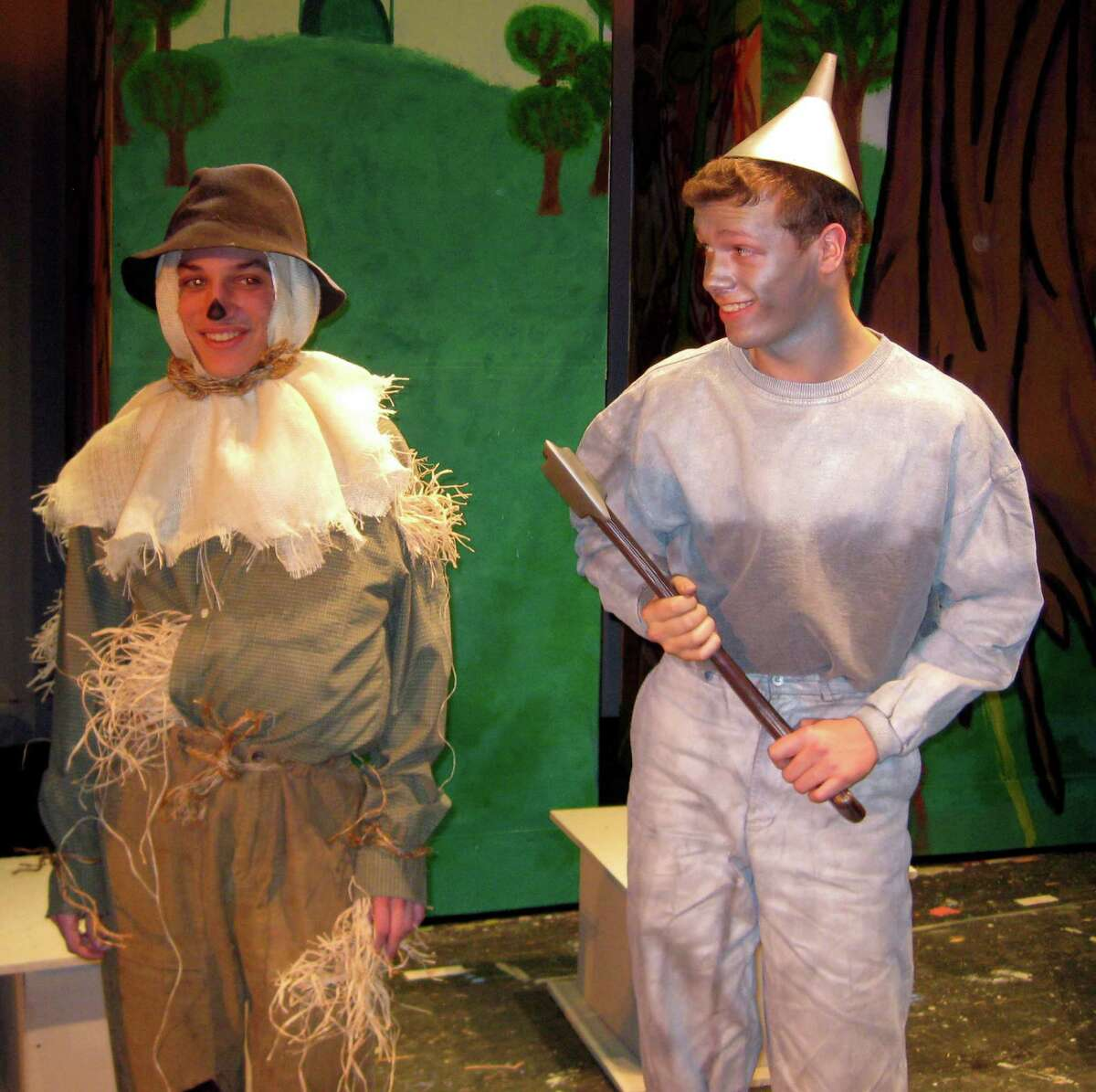 """James Purcell as Scarecrow, left, and Tim Dutton as the Tin Man rehearse a scene from Fairfield Ludlowe High School's production of """"The Wizard of Oz."""" The musical is planned Friday, April 25, and Saturday, April 26, in the school's auditorium."""
