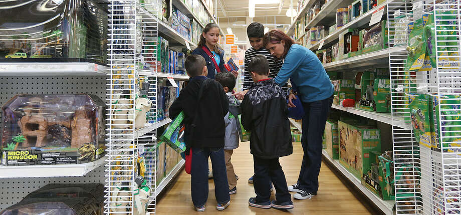 "A family from the Mexican state of San Luis Potosi shops at Toys ""R""Us. Mexican shoppers flock to the San Antonio area for bargains during Holy Week. Photo: Jerry Lara / San Antonio Express-News / © 2013 San Antonio Express-News"