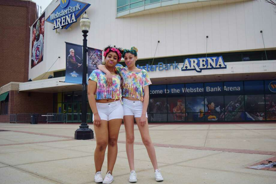 Nicole Dixon and Jacelia Rios, of Bridgeport, attend Foam N' Glow at Bridgeport's Webster Bank Arena on Friday, April 11, 2014. Photo: Todd Tracy, Contributed Photo / Connecticut Post Contributed