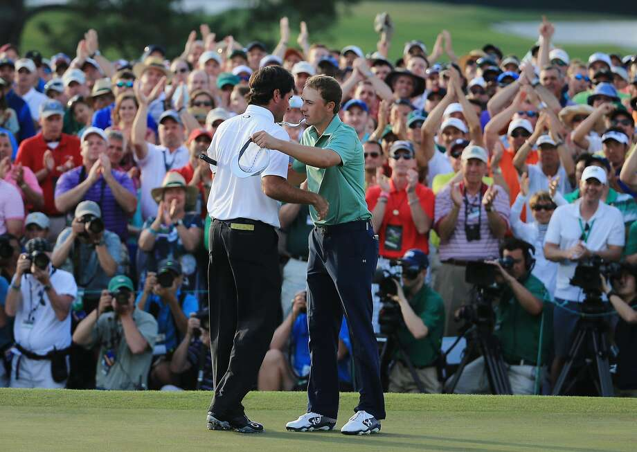 Bubba Watson hugs Jordan Spieth (right) after Watson prevailed Sunday. Photo: David Cannon, Getty Images