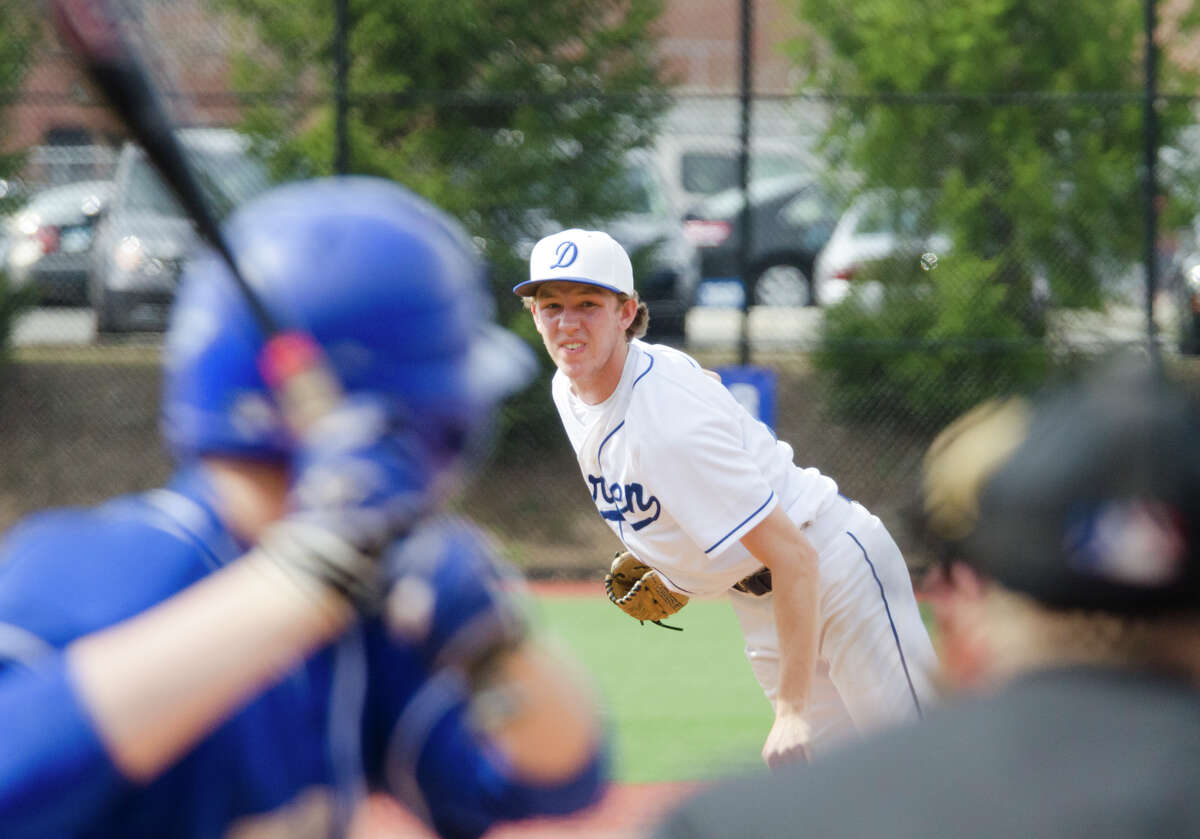 Darien's Conor Davey (11) pitches to Fairfield Ludlowe during the baseball game at Darien High School on Monday, Apr. 14, 2014.