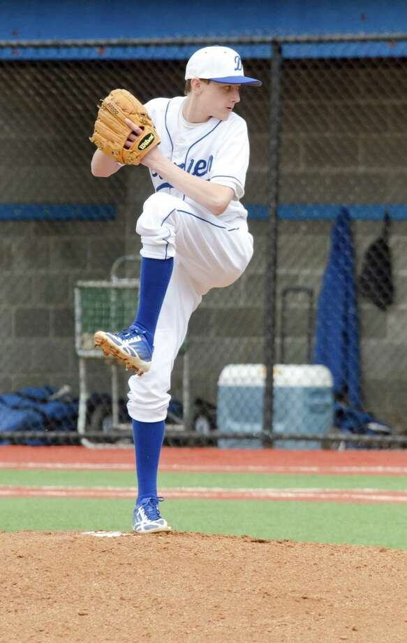 Darien's Stephen Barston (19) pitches during the baseball game against Fairfield Ludlowe at Darien High School on Monday, Apr. 14, 2014. Photo: Amy Mortensen / Connecticut Post Freelance