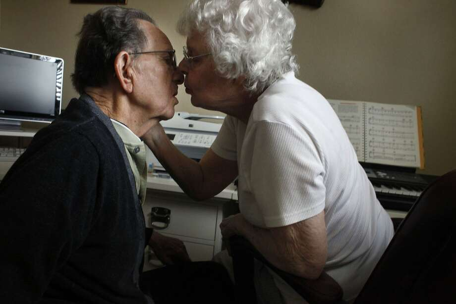 "Dr. Harold Moore, 85 years old, gets a kiss from  his wife Marion after she plays' 'Let me call you sweetheart"" on the piano, Tuesday April 8, 2014, at their home in Lafayette, Calif.  They have been married for 64 years after he and his family immigrated from Oklahoma when he was 13 years old. Photo: Lacy Atkins, SFC"