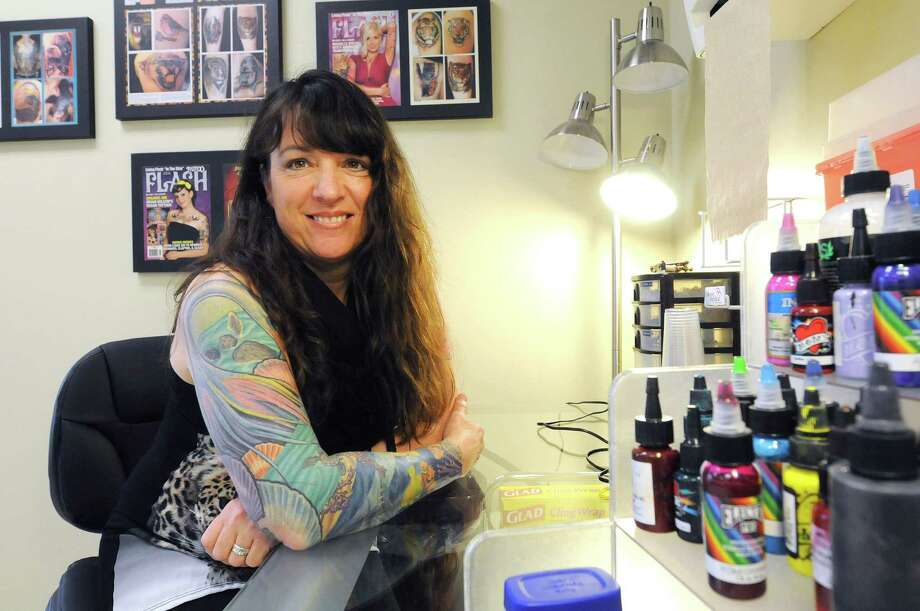 Lisa Fasulo, head instructor of the Tattoo Artistry course at Austin's School of Spa Technology, poses in her classroom on Monday, April 14, 2014, in Albany, N.Y.    (Paul Buckowski / Times Union) Photo: Paul Buckowski / 00026475A