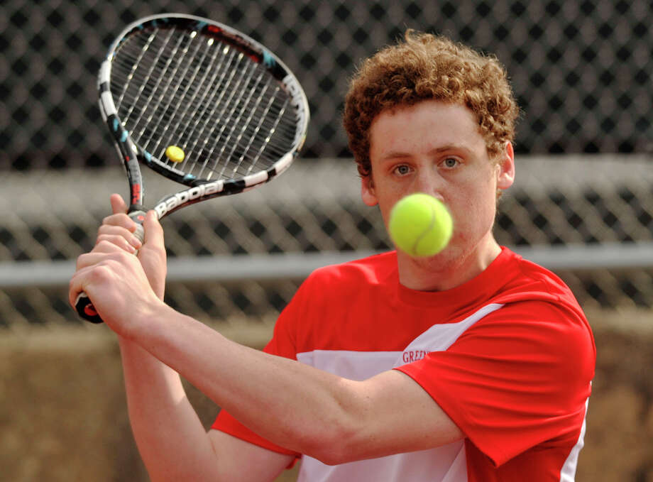 Greenwich's Ari Cepelewicz returns the ball to Darien's Tim Derby during their tennis match at Greenwich High School in Greenwich, Conn., on Monday, April 14, 2014. Photo: Jason Rearick / Stamford Advocate