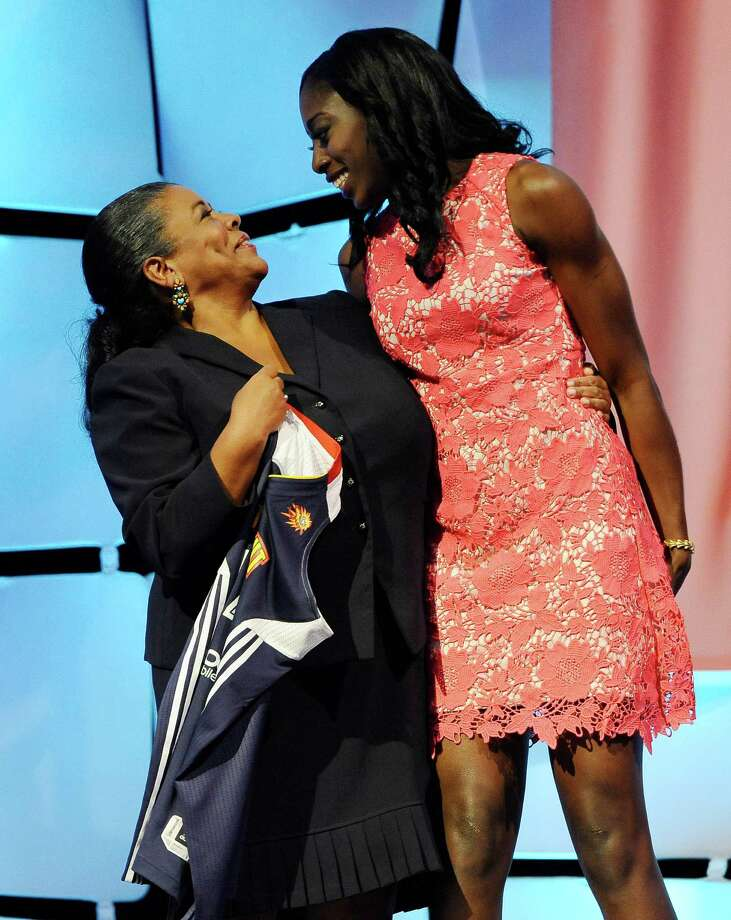 StanfordâÄôs Chiney Ogwumike, right, looks at WNBA president Laurel J. Richie after the Connecticut Sun named Ogwumike as the No. 1 pick in the WNBA basketball draft in, Monday, April 14, 2014, in Uncasville, Conn. Photo: Jessica Hill, AP / Associated Press
