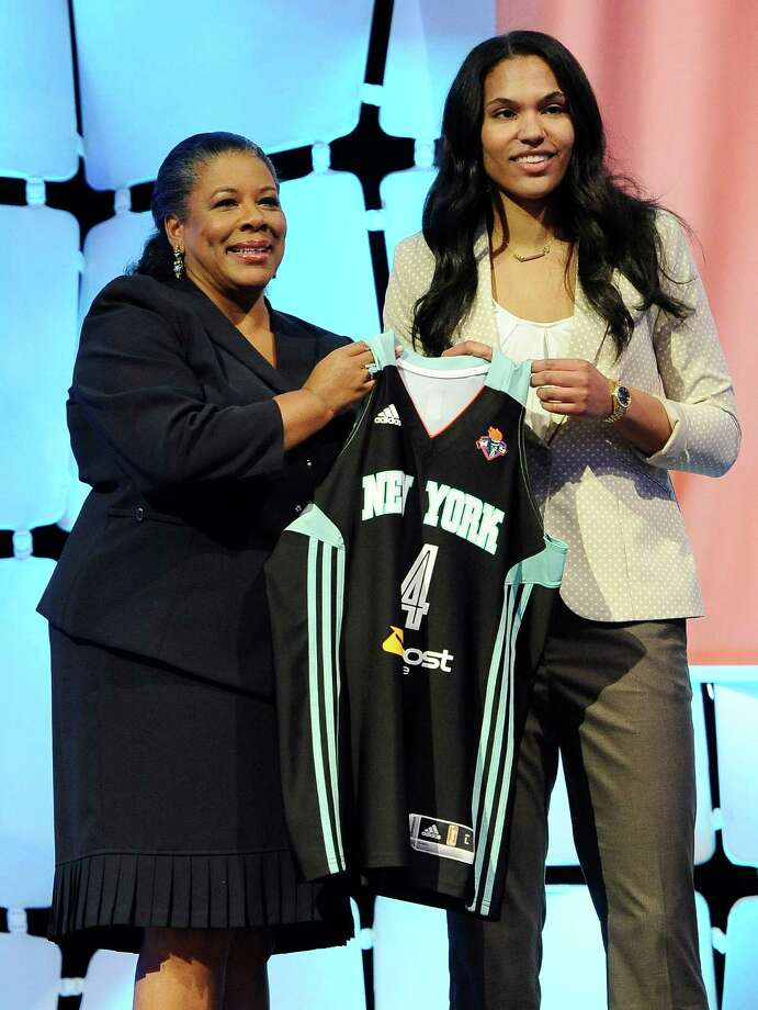 MarylandâÄôs Alyssa Thomas holds up New York Liberty jersey with WNBA president Laurel J. Richie after New York selected Thomas as the No. 4 pick in the WNBA basketball draft in, Monday, April 14, 2014, in Uncasville, Conn. Thomas was later traded to the Connecticut Sun along with Liberty's Kelsey Bone and the Liberty's 2015 first round pick for Connecticut's Tina Charles. Photo: Jessica Hill, AP / Associated Press