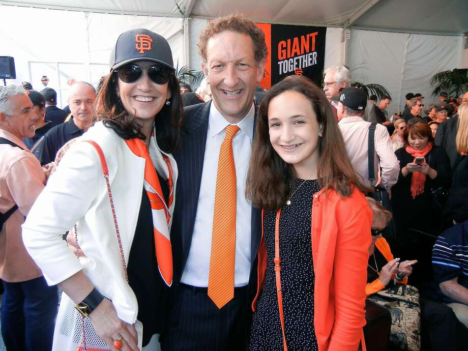 Pam Baer (left), her husband, Giants CEO Larry Baer, and their daughter, Alana, show their orange- and-black spirit at AT&T Park on Opening Day. Photo: Catherine Bigelow, Special To The Chronicle