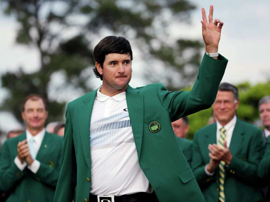 Bubba Watson waves after being presented with his green jacket after winning the Masters golf tournament Sunday, April 13, 2014, in Augusta, Ga.  (AP Photo/David J. Phillip)  ORG XMIT: AUG264 Photo: David J. Phillip / AP