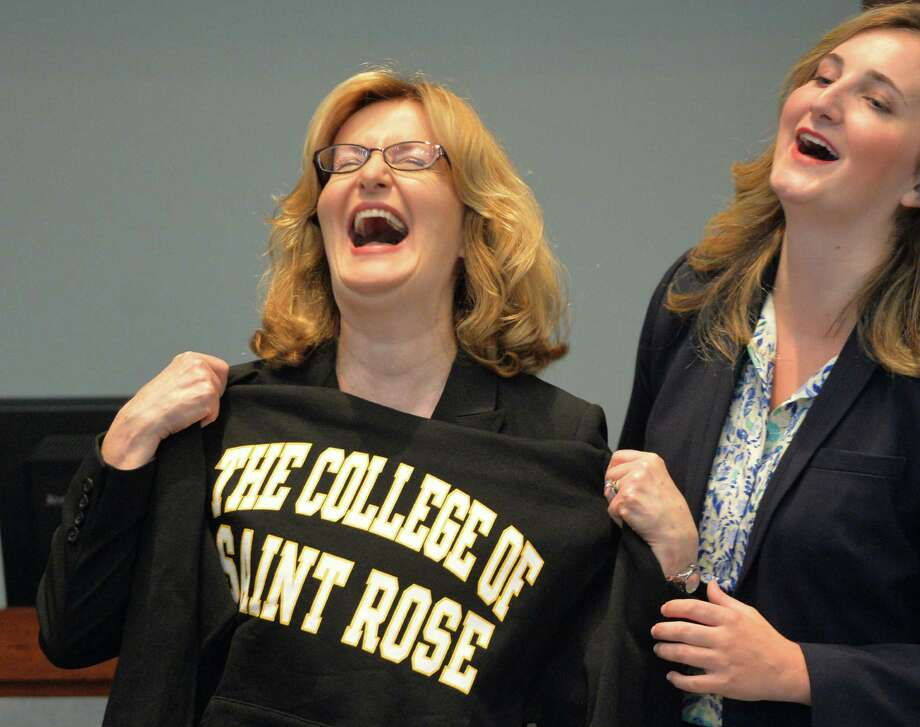 Carolyn Stefanco enjoys the moment as she stands with daughter Alexandra after being named the 11th president of the College of Saint Rose Monday afternoon, April 14, 2014, in Albany, N.Y.   (Skip Dickstein / Times Union) Photo: SKIP DICKSTEIN / 00026488A