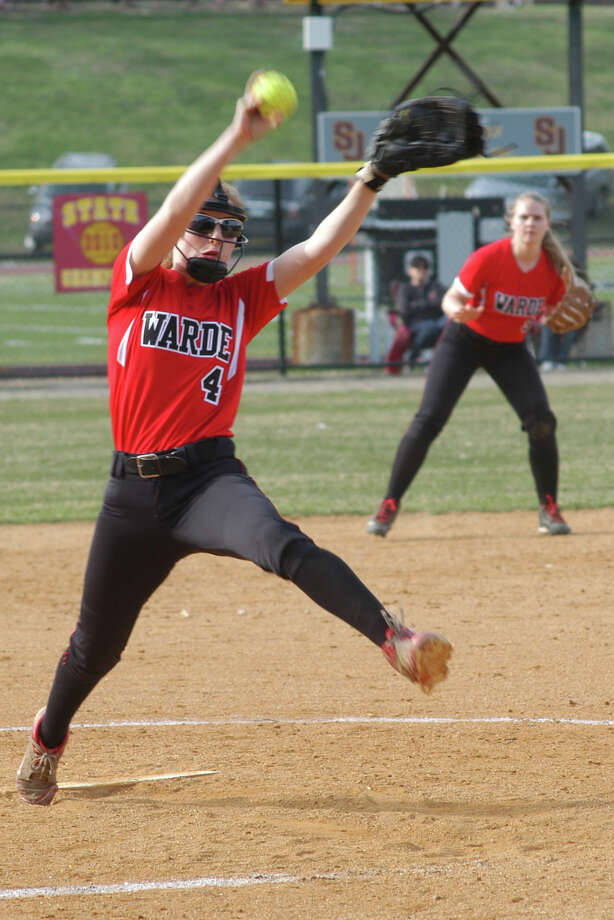 Fairfield Warde pitcher Gabbie Natoli with second baseman Kenzie Burns on Monday, April 14 in an FCIAC softball game in Trumbull. St. Joseph won 10-0 in a game between teams that each entered at 3-0. Photo: Andy Hutchison / Fairfield Citizen