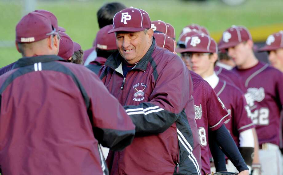 Fort Plain's, Coach Craig Phillips congratulates Fonda High School team in Boy's High School Baseball game action at Fonda, NY, on Monday, May 10, 2010.   Fort Plain won the game.     (Luanne M. Ferris / Times Union) Photo: LUANNE M. FERRIS / 00008658A