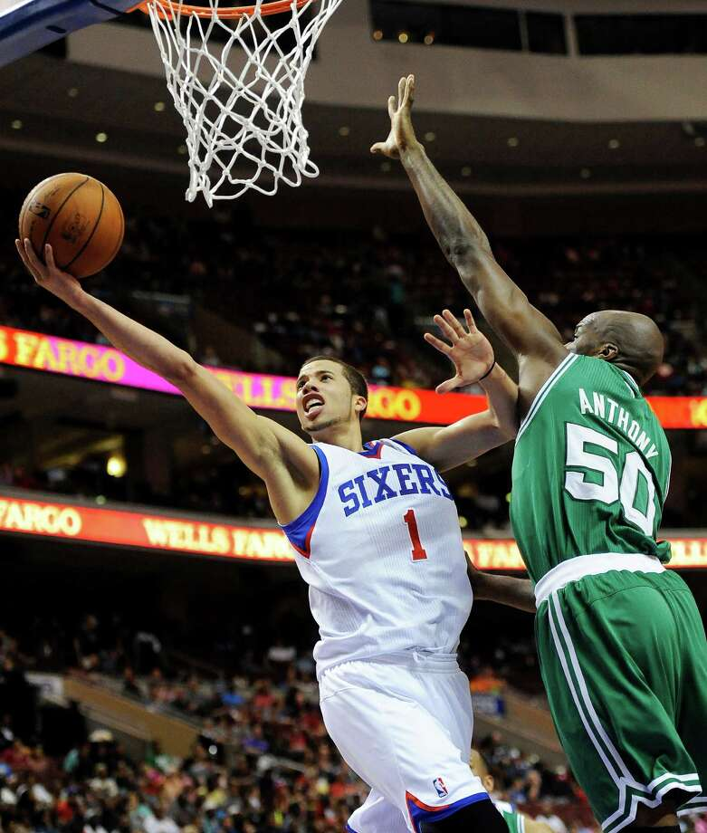 Philadelphia 76ers' Michael Carter-Williams (1) drives to the basket past Boston Celtics' Joel Anthony (50) during the second half of an NBA basketball game on Monday, April 14, 2014, in Philadelphia. The 76ers won 113-108. (AP Photo/Michael Perez) ORG XMIT: PAMP108 Photo: Michael Perez / FR168006 AP