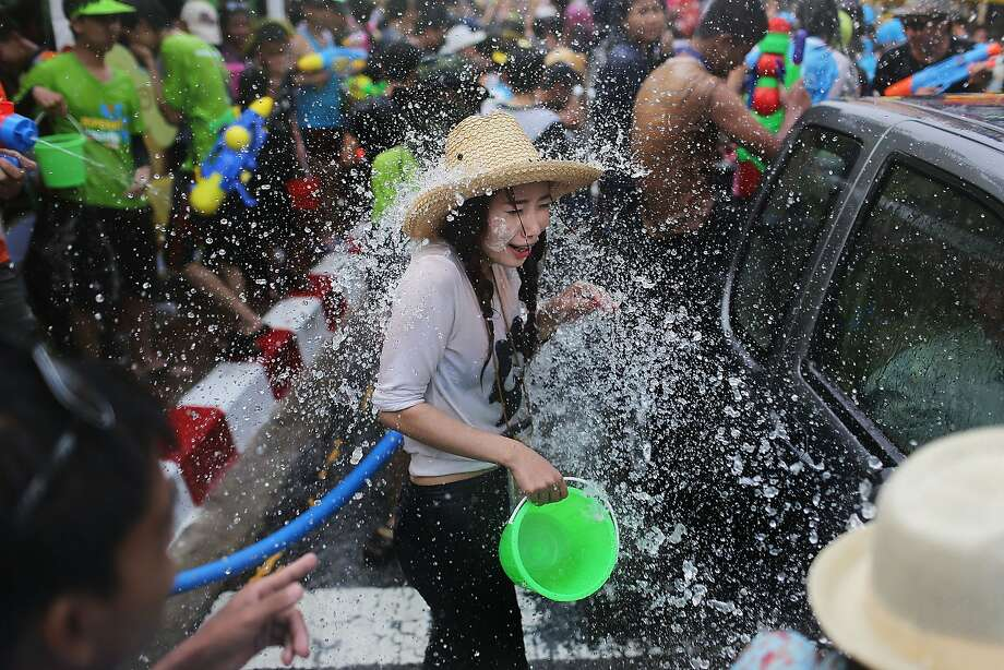 CHIANG MAI, THAILAND - APRIL 14:  Tourists and Thai residents take part in a city-wide water fight during the Songkran water festival on April 14, 2014 in Chiang Mai, Thailand. The Songkran festival, marking the traditional Thai New Year, is celebrated each year from April 13 to 15. The throwing of water was traditionally a sign of respect and well wishing during the festival.  (Photo by Taylor Weidman/Getty Images) *** BESTPIX *** Photo: Taylor Weidman, Getty Images