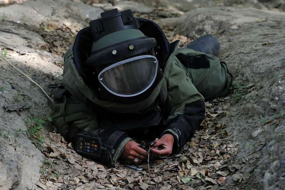 TOPSHOTS An Afghan National Army soldier participates in an IED (improvised explosive device) defusing training exercise in Jalalabad, Nangarhar province on April 14, 2014. Afghans have taken over responsibility for security from US-led forces, and this year the last of the NATO coalition's 51,000 combat troops will pull out. AFP PHOTO/Noorullah ShirzadaNoorullah Shirzada/AFP/Getty Images Photo: Noorullah Shirzada, AFP/Getty Images