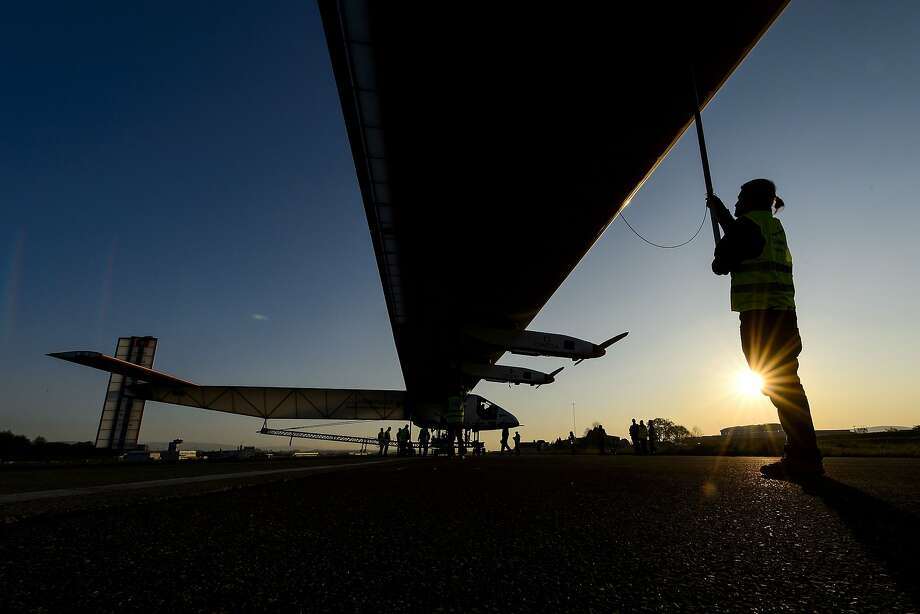 TOPSHOTS  Sun-powered plane Solar Impulse 2 HB-SIB is seen in silhouette during his first exit for test on April 14, 2014 in Payerne a year ahead of their planned round-the-world flight. Solar Impulse 2 is the successor of the original plane of the same name, which last year completed a trip across the United States without using a drop of fuel.   AFP PHOTO / FABRICE COFFRINIFABRICE COFFRINI/AFP/Getty Images Photo: Fabrice Coffrini, AFP/Getty Images