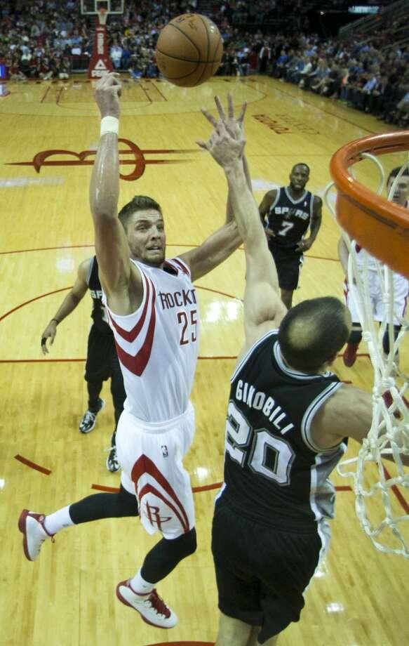 Rockets forward Chandler Parsons (25) shoots over Spurs guard Manu Ginobili. Photo: Brett Coomer, Houston Chronicle