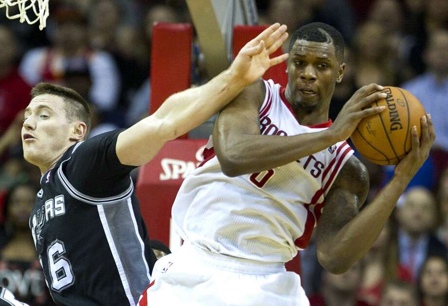 Rockets forward Terrence Jones (6) grabs a rebound away from Spurs forward Aron Baynes. Photo: Brett Coomer, Houston Chronicle