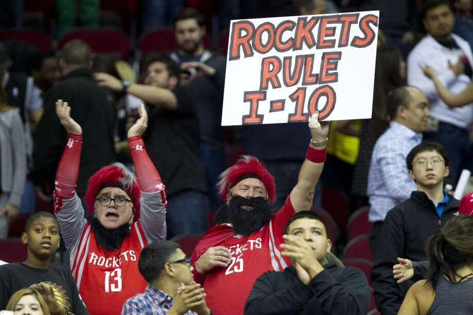 Rockets fans cheer the season sweep over the Spurs. Photo: Brett Coomer, Houston Chronicle