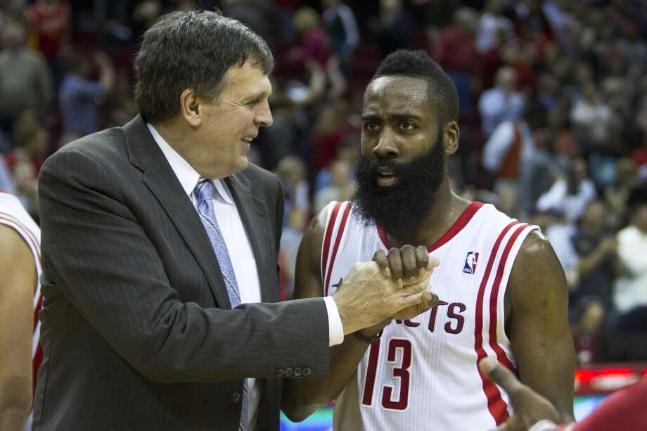 Rockets head coach Kevin McHale, left, celebrates the Rockets win. Photo: Brett Coomer, Houston Chronicle