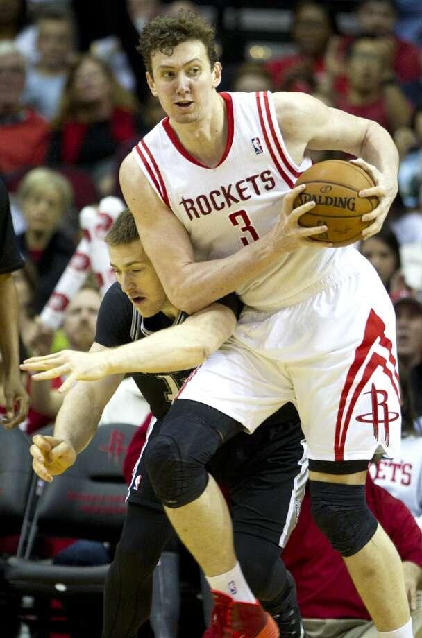 Rockets center Omer Asik (3) pulls a rebound away from Spurs forward Aron Baynes. Photo: Brett Coomer, Houston Chronicle