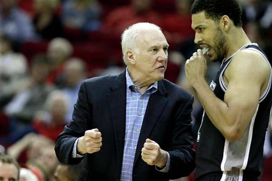 San Antonio Spurs' coach Gregg Popovich, left, talks with Jeff Ayres in the first half of an NBA basketball game against the Houston Rockets Monday, April 14, 2014, in Houston. (AP Photo/Pat Sullivan) Photo: Pat Sullivan, AP / AP