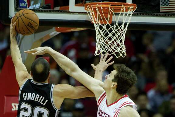 Rockets center Omer Asik, right, must figure that Spurs guard Manu Ginobili can't score if he can't see. The Rockets won Monday to complete a four-game season sweep against San Antonio.