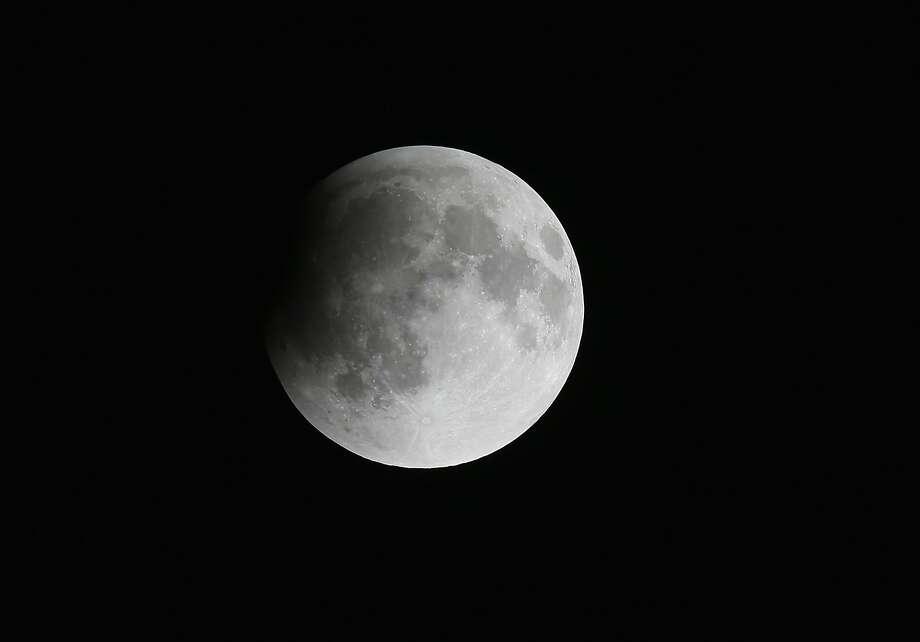 The moon is seen as it begins to head into a total lunar eclipse on April 15, 2014 in Miami, Florida. People in most of north and south America will be able to witness this year's first total lunar eclipse, which will cause a 'blood moon' and is the first of four in a rare Tetrad of eclipses over the next two years. Photo: Joe Raedle, Getty Images