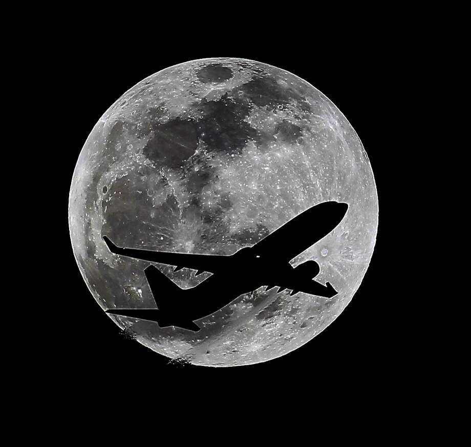 An airliner crosses the moon's path, Monday, April 14, 2014, above Whittier, Calif., approximately one hour before a total lunar eclipse. Then, on April 29, the Southern Hemisphere will be treated to a rare type of solar eclipse. In all, four eclipses will occur this year, two lunar and two solar.  Photo: Nick Ut, Associated Press