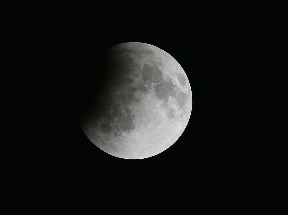 The moon is seen as it  heads into a total lunar eclipse on April 15, 2014 in Miami, Florida. People in most of north and south America will be able to witness this year's first total lunar eclipse, which will cause a 'blood moon' and is the first of four in a rare Tetrad of eclipses over the next two years. Photo: Joe Raedle, Getty Images