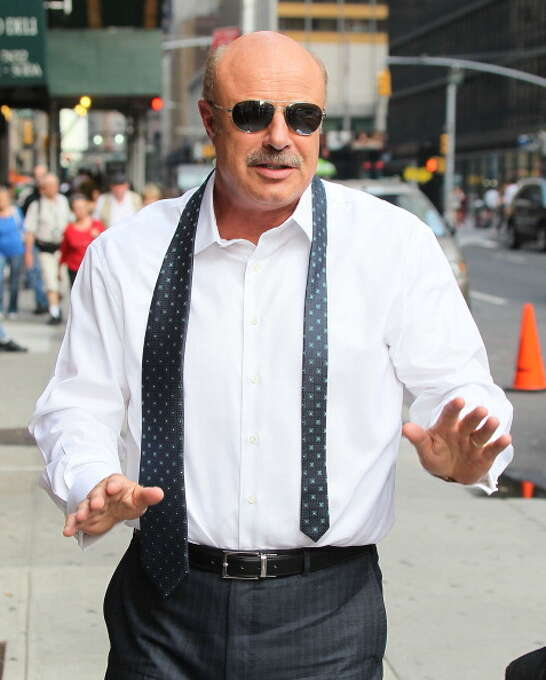 """Dr. Phil arrives to """"Late Show with David Letterman"""" at Ed Sullivan Theater on September 12, 2013 in New York City.  (Photo by Jeffrey Ufberg/WireImage) Photo: Jeffrey Ufberg, WireImage / 2013 Jeffrey Ufberg"""