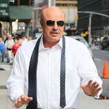 "Dr. Phil arrives to ""Late Show with David Letterman"" at Ed Sullivan Theater on September 12, 2013 in New York City.  (Photo by Jeffrey Ufberg/WireImage)"