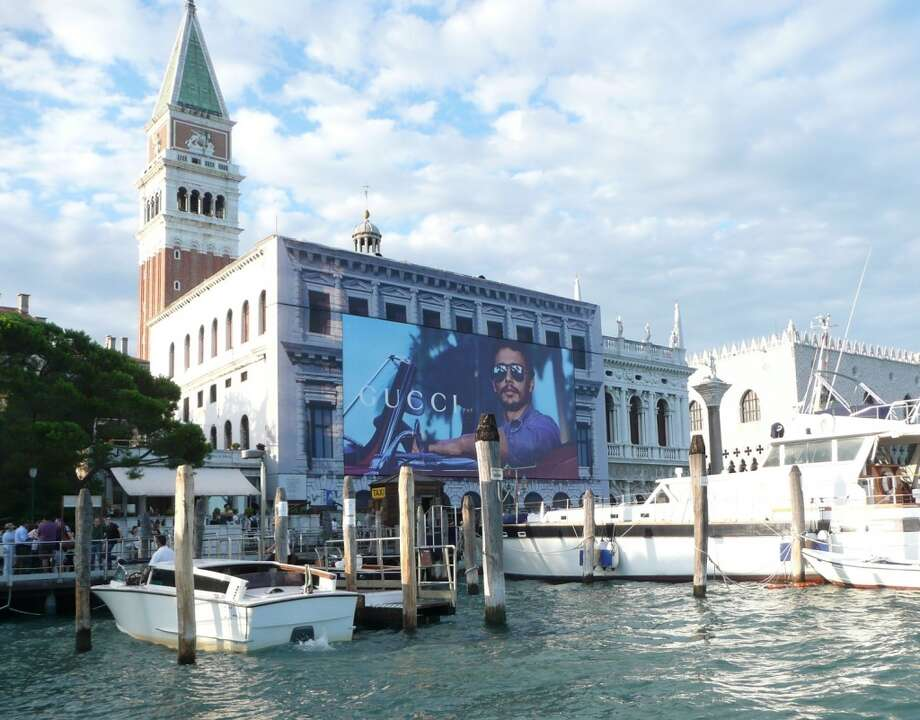James Franco -- that's him, in sunglasses, in a Gucci advertisement, hung from St. Mark's in Venice.