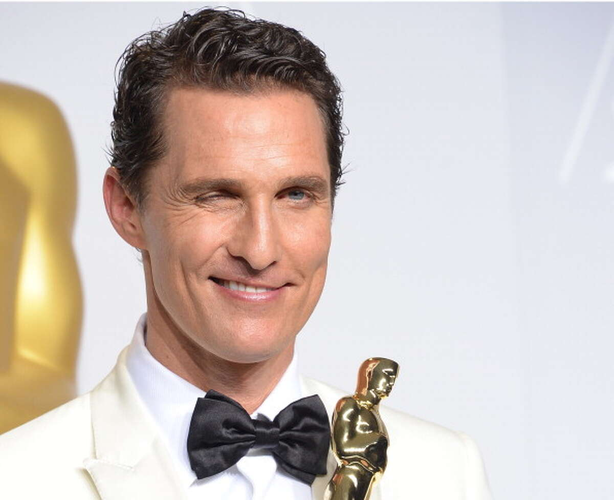 """Matthew McConaughey celebrates in the press room after winning the Best Actor Oscar for his role in true-life AIDS activist drama """"Dallas Buyers Club"""" during the 86th Academy Awards on March 2nd, 2014 in Hollywood, California. AFP PHOTO / Joe KLAMAR (Photo credit should read JOE KLAMAR/AFP/Getty Images)"""