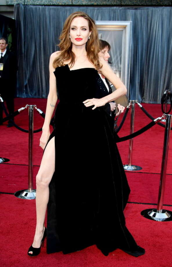 Angelina Jolie arrives at the 84th Annual Academy Awards held at Hollywood & Highland Centre on February 26, 2012 in Hollywood, California. (Photo by Dan MacMedan/WireImage) Photo: Dan MacMedan, WireImage / 2012 Dan MacMedan
