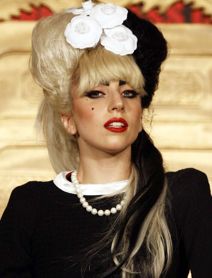 """Lady Gaga attends a news conference in Taipei, Taiwan to promote her new album """"Born This Way"""".  Lady gaga will perform at """"A Decade of Difference: A Concert Celebrating 10 Years of the William J. Clinton Foundation"""" at the Hollywood bowl in Los Angeles on Oct. 15.  (AP Photo/Wally Santana, file) Photo: Wally Santana, Associated Press"""