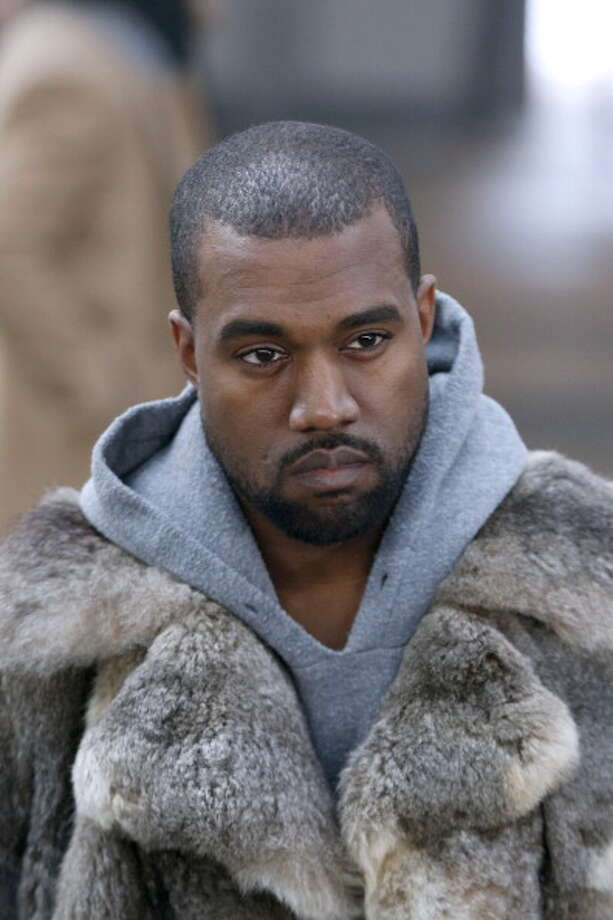 US musician Kanye West arrives to attend Givenchy's Fall/Winter 2014-2015 men's fashion show in Paris on January 17, 2014.   AFP PHOTO FRANCOIS GUILLOT        (Photo credit should read FRANCOIS GUILLOT/AFP/Getty Images) Photo: FRANCOIS GUILLOT, AFP/Getty Images / 2014 AFP