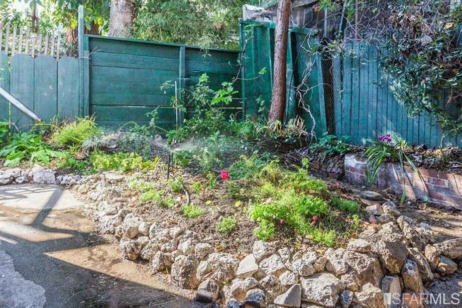 Outdoor space with rocks. Photos: Redfin/MLS