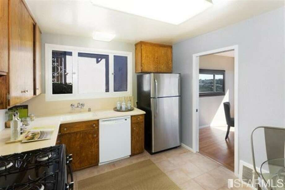 Less updated kitchen. Photos: Redfin/MLS