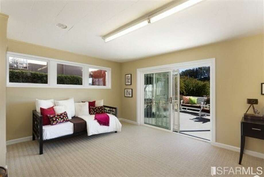 Cool extra room leading to outdoor space. Photos: Redfin/MLS