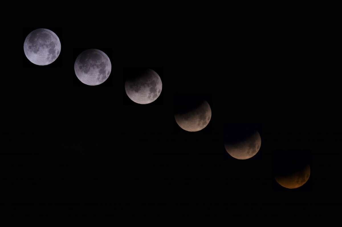 A combination of 6 pictures shows the moon in different stages of a total lunar eclipse from the Spanish Canary island of Tenerife on April 15, 2014.