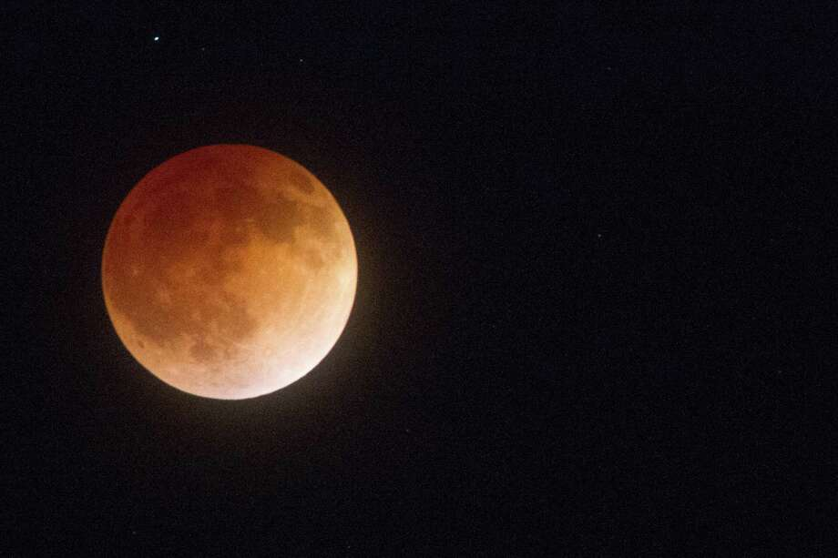 "The ""Blood Moon"" lunar eclipse is visible in the skies above Oakland, Calif. early Tuesday, April 15, 2014. Photo: Douglas Zimmerman"