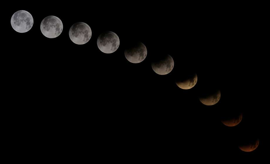 "A combination of 10 pictures shows the moon in different stages of a total lunar eclipse seen from the Spanish Canary island of Tenerife on April 15, 2014. People in most of north and south America should be able to witness this year's first total lunar eclipse, which will cause a ""blood moon"" and is the first of four in a rare Tetrad of eclipses over the next two years. Photo: Desiree Martin, AFP/Getty Images"